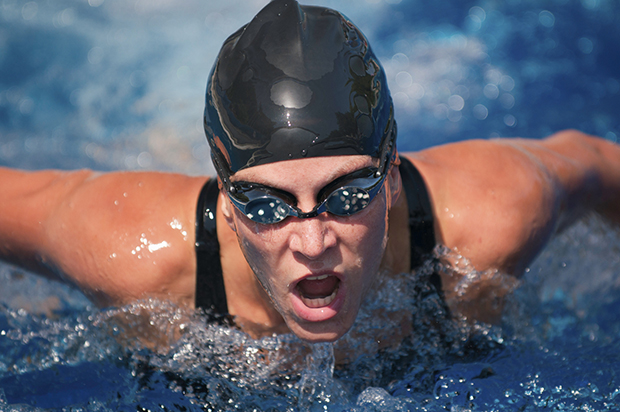 Female butterfly swimmer in action